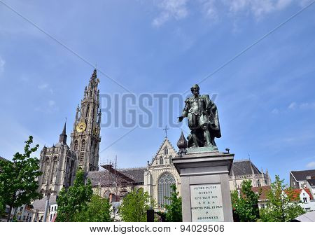 Antwerp, Belgium - May 10, 2015: Statue Of Rubens With Cathedral Of Our Lady In Antwerp, Belgium.