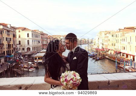 Bride And Groom On A Bridge In Venice