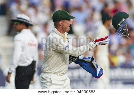 NOTTINGHAM, ENGLAND - July 12, 2013: Brad Haddin catches a helmet during day three of the first Investec Ashes Test match at Trent Bridge Cricket Ground on July 12, 2013 in Nottingham, England.