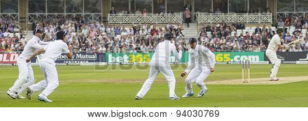 NOTTINGHAM, ENGLAND - July 10, 2013: England's Joe Root catches the ball to dismiss Shane Watson during day one of the first Investec Ashes Test match at Trent Bridge Cricket Ground