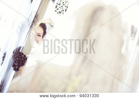 Face Of A Bride In The Mirror