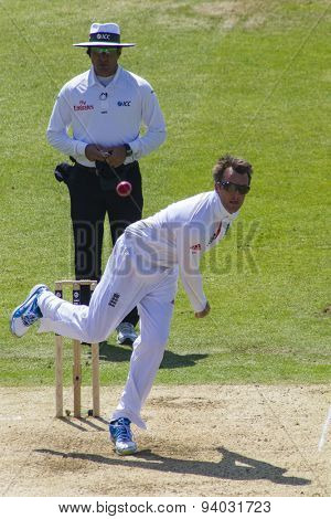 NOTTINGHAM, ENGLAND - July 11, 2013: Umpire Aleem Dar warches on as Graeme Swann bowls the ball during day two of the first Investec Ashes Test match at Trent Bridge Cricket Ground