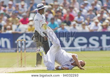 NOTTINGHAM, ENGLAND - July 14, 2013: Stuart Broad attempts to stop the ball of his bowling during day five of the first Investec Ashes Test match at Trent Bridge Cricket Ground on July 14, 2013