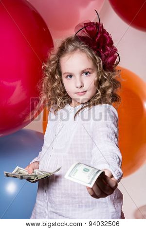 Portrait Of A Girl Offers Money Dollars Looking Forward To The Camera.