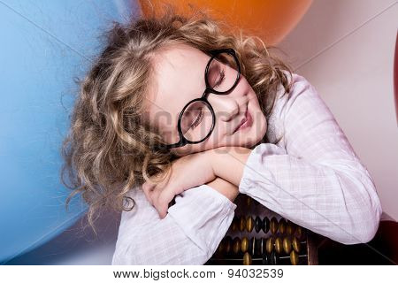 Portrait Of Teen Girl Dreaming Smiling In Glasses With Eyes Closed Against The Background Of Large R