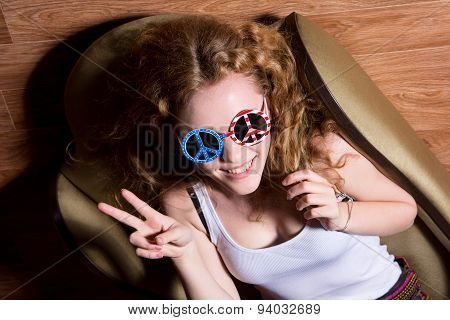 Young Girl Show Victory Sign Smiling With Curly Hair Wearing Sunglasses