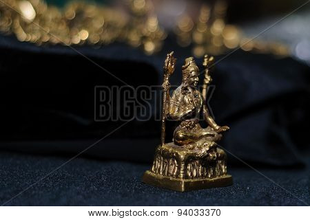 statuette of the deity