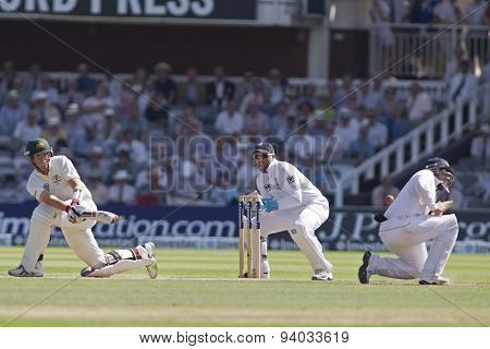 LONDON, ENGLAND - July 19 2013: Ian Bell takes evasive action whilst in a close fielding position as Peter Siddle hits the ball during the Investec Ashes 2nd test match, at Lords Cricket Ground