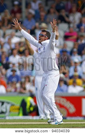 MANCHESTER, ENGLAND - August 01 2013: Graeme Swann appeals for the wicket of Chris Rogers during day one of  the Investec Ashes 3rd test match at Old Trafford Cricket Ground
