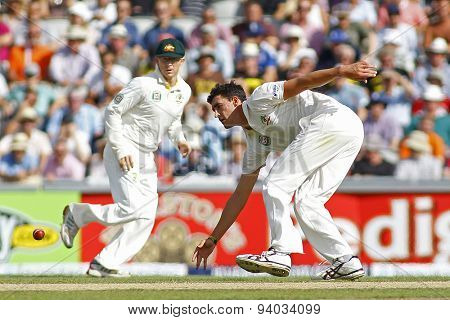 MANCHESTER, ENGLAND - August 02 2013: Chris Rogers and Mitchell Starc during day two of  the Investec Ashes 3rd test match at Old Trafford Cricket Ground, on August 02, 2013 in London, England.