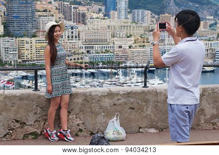 Asian couple make photo at the viewpoint in Monaco.