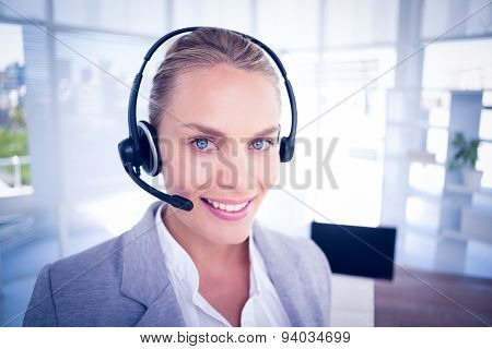 Businesswoman taking calls in the office