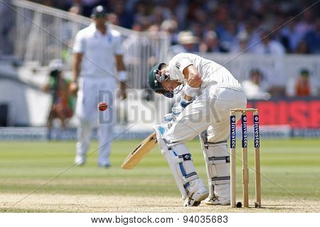 LONDON, ENGLAND - July 21 2013: Michael Clarke gets hit on the chest from the bowling of Stuart Broad during day four of the Investec Ashes 2nd test match, at Lords Cricket Ground