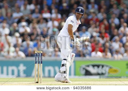 MANCHESTER, ENGLAND - August 03 2013: Alastair Cook looks back after hitting the ball and gets caught out by Brad Haddin during day three of  the Investec Ashes 3rd test match