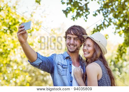 Hipster couple taking a selfie on a summers day