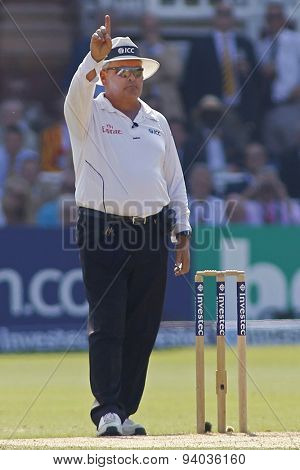 LONDON, ENGLAND - July 21 2013: Umpire Marais Erasmus signals out after reversing his decision after a DRS review during day four of the Investec Ashes 2nd test match, at Lords Cricket Ground