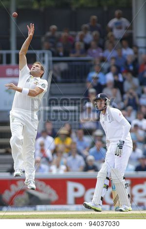 MANCHESTER, ENGLAND - August 04 2013: Ryan Harris fields the ball off his own bowling as Stuart Broad looks on during the Ashes 4th test match at Old Trafford Cricket Ground, on August 04, 2013