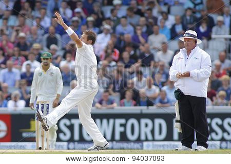 MANCHESTER, ENGLAND - August 04 2013: Ryan Harris and umpire Marais Erasmus during day four of  the Investec Ashes 4th test match at Old Trafford Cricket Ground, on August 04, 2013 in London, England.