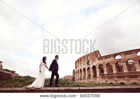 Bride And Groom Near Colosseum In Rome