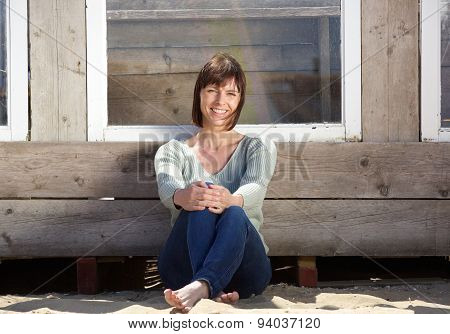 Charming Older Woman Sitting Outside