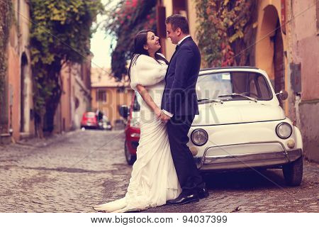 Bride And Groom On Street, Near Old Car