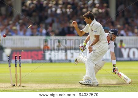 LONDON, ENGLAND - July 20 2013: Ian Bell runs a single as Ashton Agar watches the get broken from a throw from a fielder during day three of the Investec Ashes 2nd test match, at Lords Cricket Ground