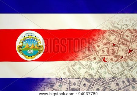 Pile of dollars against costa rica national flag