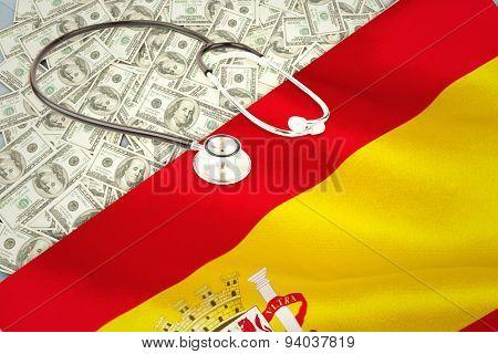 stethoscope against digitally generated spanish national flag
