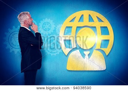 Thoughtful mature businessman posing against blue background
