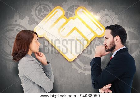 Concentrating businesswoman against white and grey background