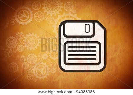 floppy disk against orange background