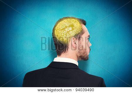 Elegant businessman in suit thinking against blue background