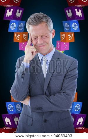 Businessman with headache against blue background with vignette