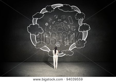 Thinking businesswoman against black wall