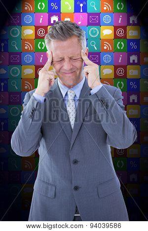 Businessman with headache against app wall