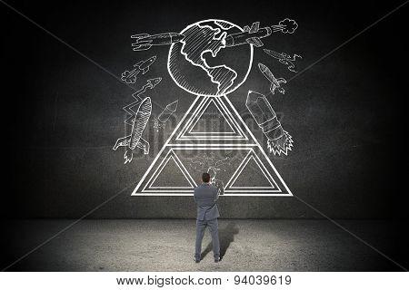 Thinking businessman against black wall