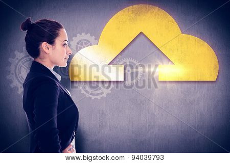 Serious businesswoman against white and grey background
