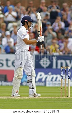 CHESTER LE STREET, ENGLAND - August 09 2013: Alastair Cook raises his bat to acknowledge the crowd after scoring 50 runs during day one of the Ashes 4th test match at The Emirates Riverside Stadium