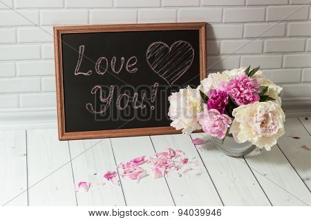 Chalkboard with inscription Love You and peonies