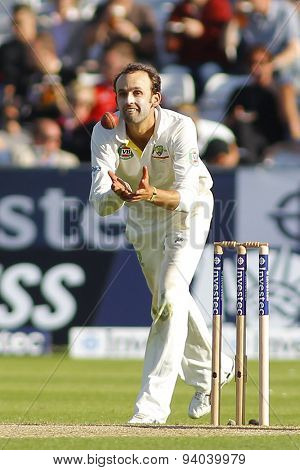 CHESTER LE STREET, ENGLAND - August 09 2013: Nathan Lyon fields the ball of his own bowling during day one of the Investec Ashes 4th test match at The Emirates Riverside Stadium