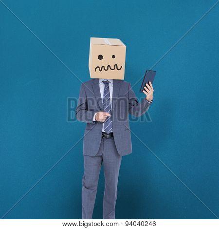 Anonymous businessman against blue background