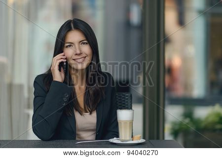 Smiling Woman Chatting On Her Mobile