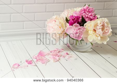Bouquet of pink and white peonies in vase