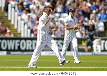 CHESTER LE STREET, ENGLAND - August 11 2013: Graeme Swann celebrates taking the wicket of Brad Haddin during day three of the Investec Ashes 4th test match at The Emirates Riverside Stadium