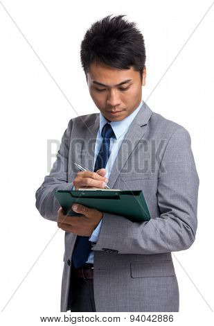 Asian businessman take note on clipboard