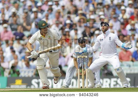 LONDON, ENGLAND - August 21 2013: Shane Watson runs a single as Matt Prior reacts during day one of the 5th Ashes cricket match between England and Australia played at The Kia Oval Cricket Ground