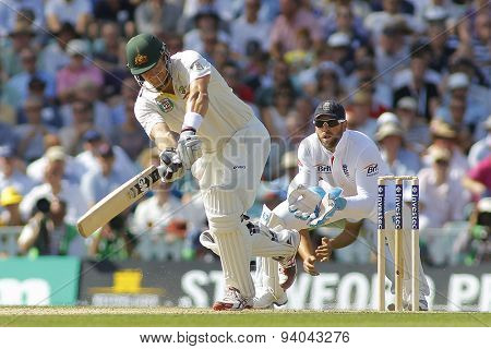 LONDON, ENGLAND - August 21 2013: Shane Watson hits the ball as Matt Prior watches on during day one of the 5th Investec Ashes cricket match between England and Australia