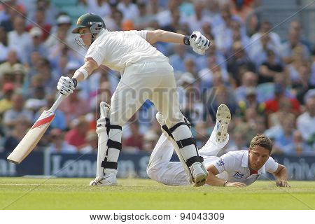 LONDON, ENGLAND - August 21 2013: Simon Kerrigan fielding of his own bowling as Steven Smith attempts to make his ground during day one of the 5th Ashes cricket match between England and Australia