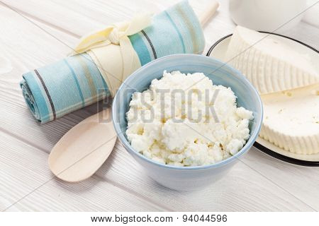 Dairy products on wooden table. Milk, cheese and curd
