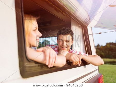 Young couple sitting in a camper van
